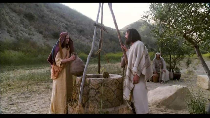 En kvinna och Jesus samtalar vid en brunn.